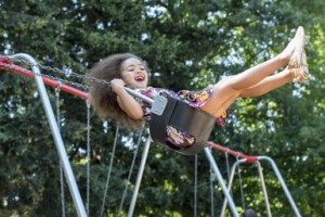Fig. 1  A child on a swing is an example of an oscillator.  The period of oscillation is the time it takes her to complete one cycle, swinging forward and back to her starting position. (About.com)