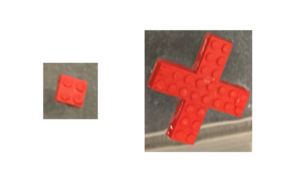 2x2 Lego brick (left) with four 2x3 Lego bricks affixed (right).
