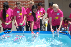 Campers built and tested submersible remotely operated vehicles (ROVs), and then competed to perform various underwater tasks with their ROVs, such as picking up the greatest number of floating rings. Girls learned to use power tools, soldered circuits, designed and assembled their submersibles.