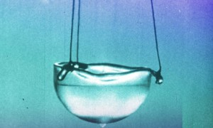 Superfluid helium exhibits many strange behaviors, like spontaneously climbing the sides of its container and spilling out. (BBC)