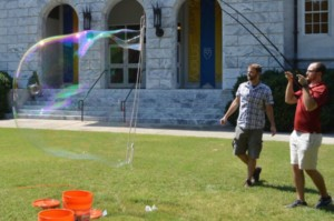 Physicist Justin Burton (left) and graduate student Stephen Frazier experiment with giant soap bubbles on Emory University's Quad.